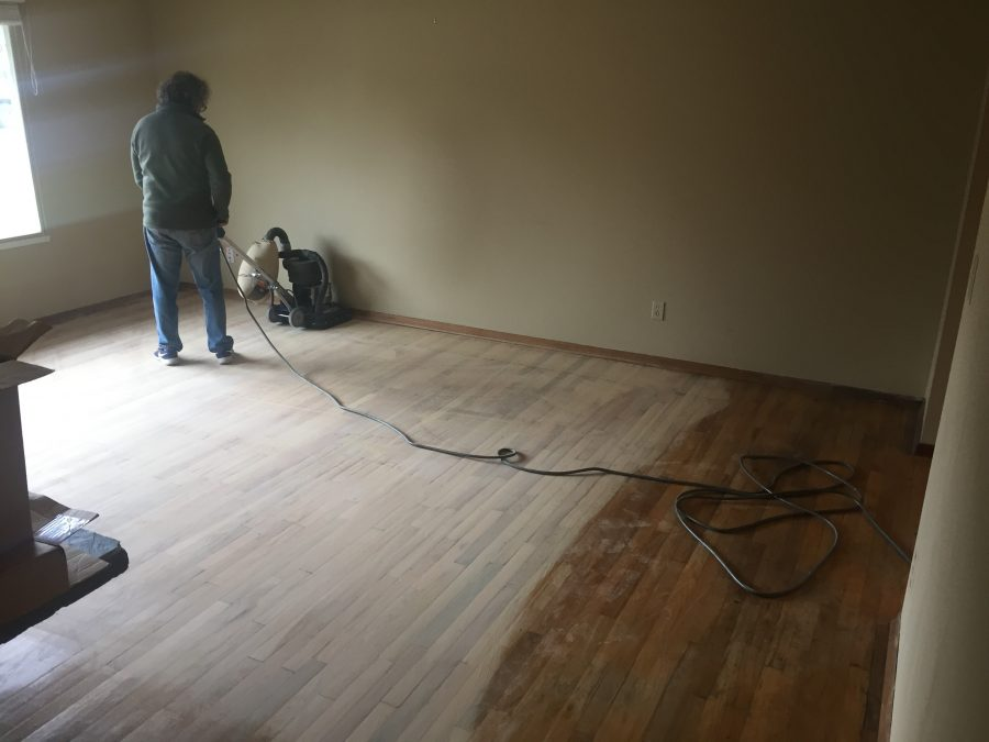 Kemp sanding the living room